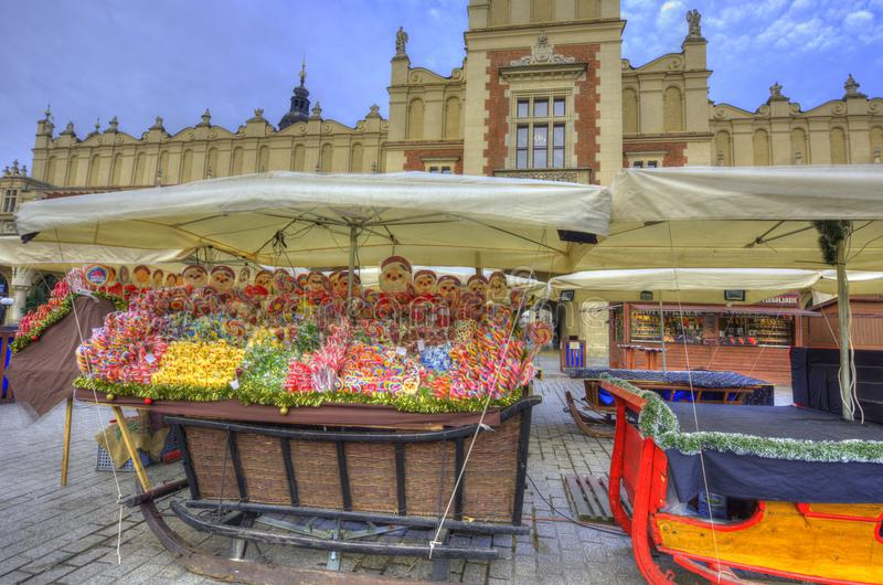 Krakow Christmas Market 2017. Early morning at the Krakow Christmas Market in Old Town Main Market Square. A sleigh full of candy in front of the Cloth Hall stock images