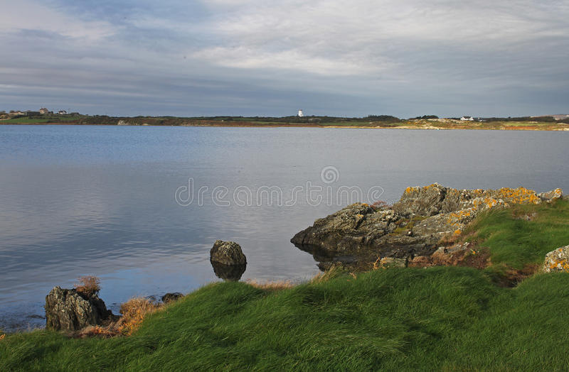 Early morning landscape, four mile bridge, Anglesey. Early morning landscape, Four Mile Bridge towards Holyhead and north stack, Anglesey , Wales stock photography