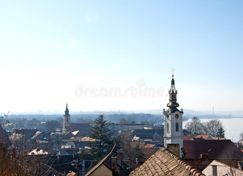 Early morning landscape of the old quarter Gardos and river Danube, Zemun, Serbia. Early morning landscape of the roofs and church towers of the nostalgic old stock images