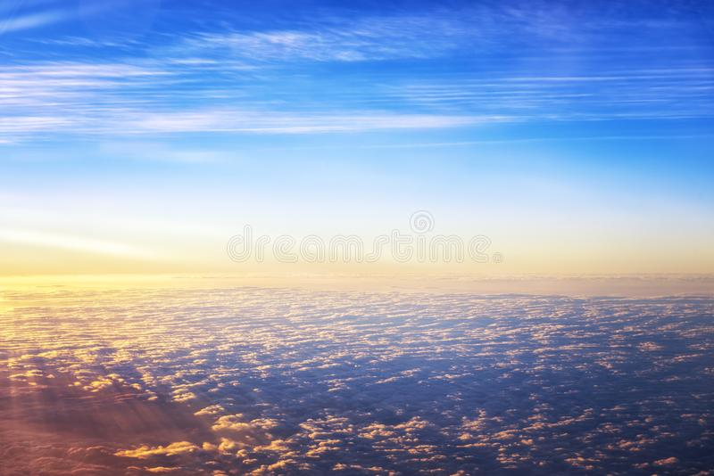 Early morning light bright sky above cloud on the plane view royalty free stock photo
