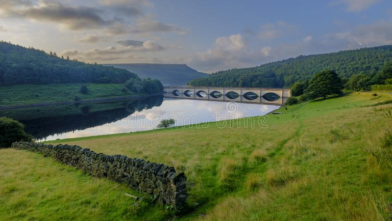 Early morning light on the Lady Bower Reservoir and Snake Road Bridge, Peak District, UK stock images