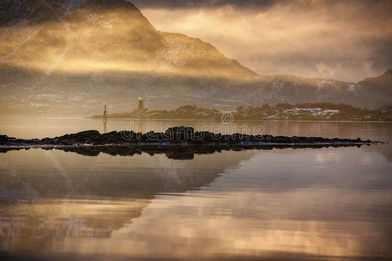 Early morning light. Over the water of Lofoten island, Norway royalty free stock image