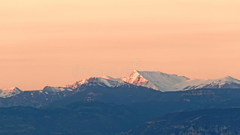 Early Morning Light on Snow Capped Peloponnese Mountain, Greece. Early morning sunrise warm light on fresh Spring snow on a Peloponnese mountain top, Greece royalty free stock photos