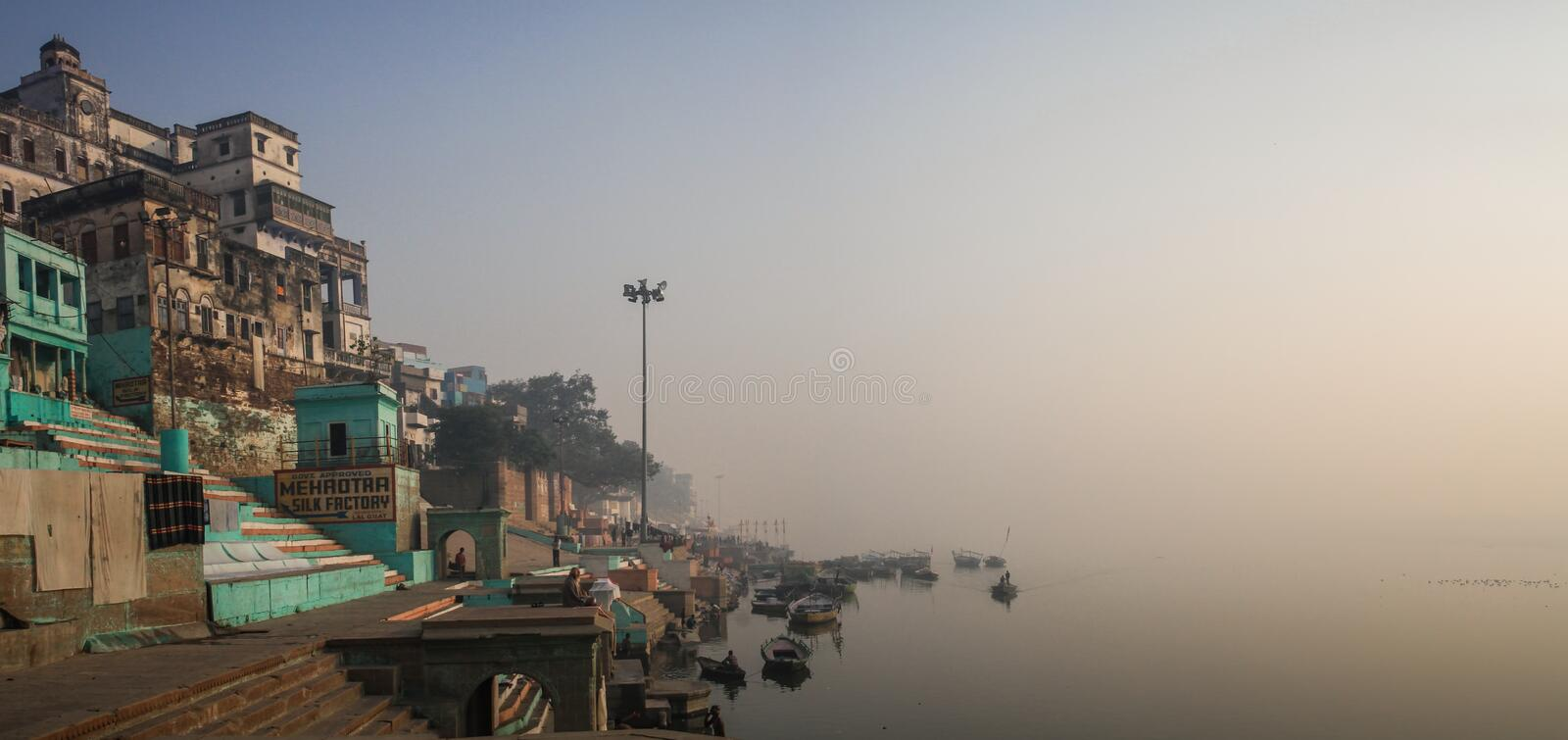 Early morning meditation and bathing on the ganga ghats in Varanasi, Uttar Pradesh, India. Varanasi also known as Benares is a city on the banks of the Ganges in stock photography
