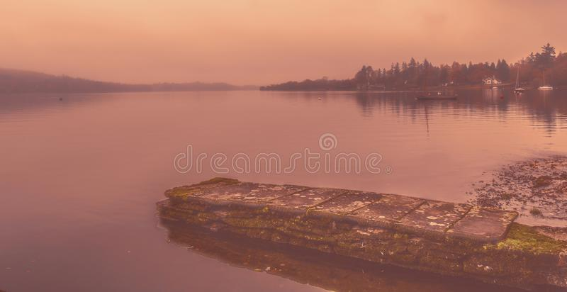 Early morning mist over Lake Windermere royalty free stock photo