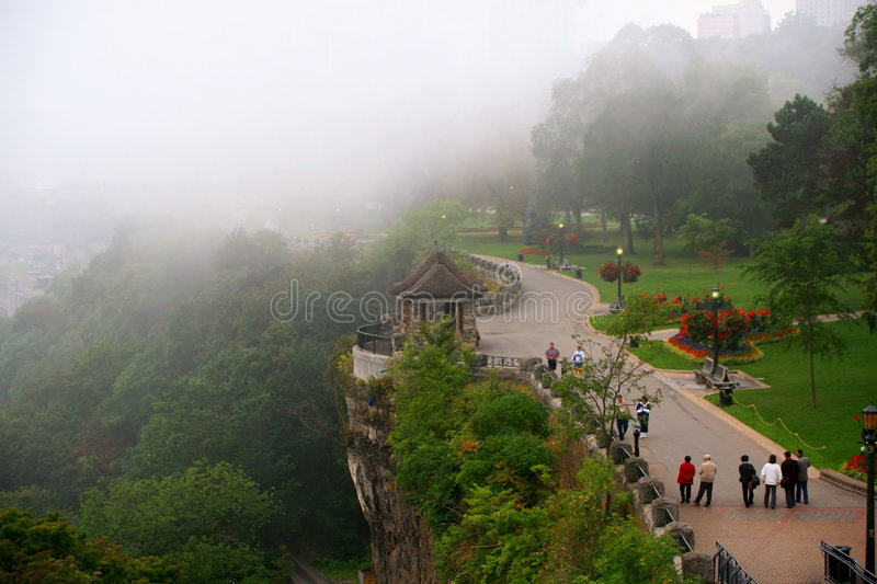 An early morning mist shrouded walk with the Niagara Parkway on one side with the Niagara Gorge on t. Walking the Mist Shrouded Parkway of Niagara Falls stock photo