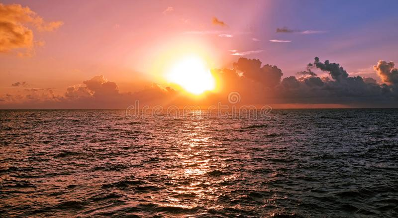 Early morning over the Caribbean sea, sunrise and clouds stock photo