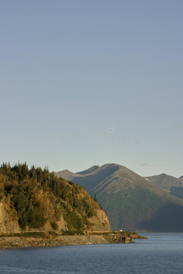Early morning over Prince William Sound. In the Gulf of Alaska with forested mountains and a tranquil sea stock photos