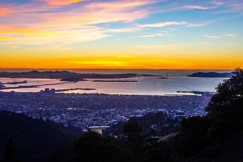 Early morning over the San Francisco Bay. The sun begins to rise over San Francisco and the Golden Gate Bridge stock photos