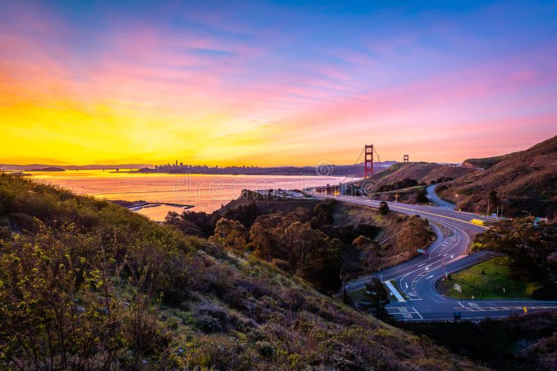 Early morning over the San Francisco Bay. The sun begins to rise over San Francisco and the Golden Gate Bridge royalty free stock photo