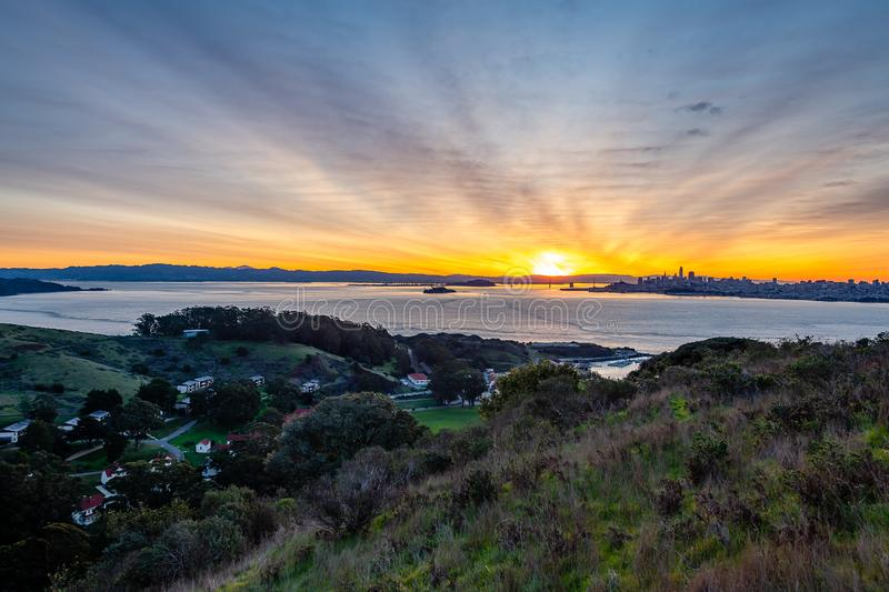 Early morning over the San Francisco Bay. The sun begins to rise over San Francisco and the Golden Gate Bridge stock images