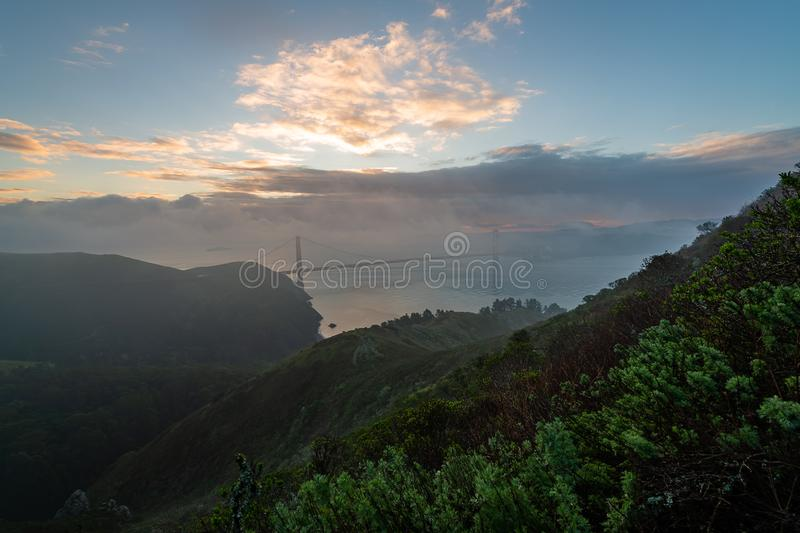 Early morning over the San Francisco Bay. The sun begins to rise over San Francisco and the Golden Gate Bridge stock photography