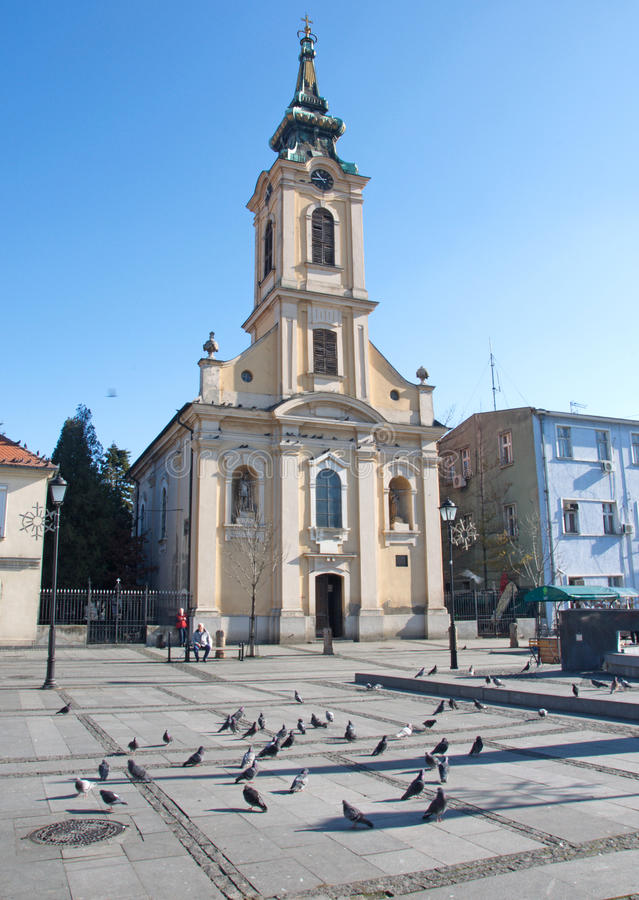 Early morning panorama of the Old Square with neo-baroque church, Zemun. Early morning panorama the Old Square with Neo Baroque church and pigeons in Zemun royalty free stock images