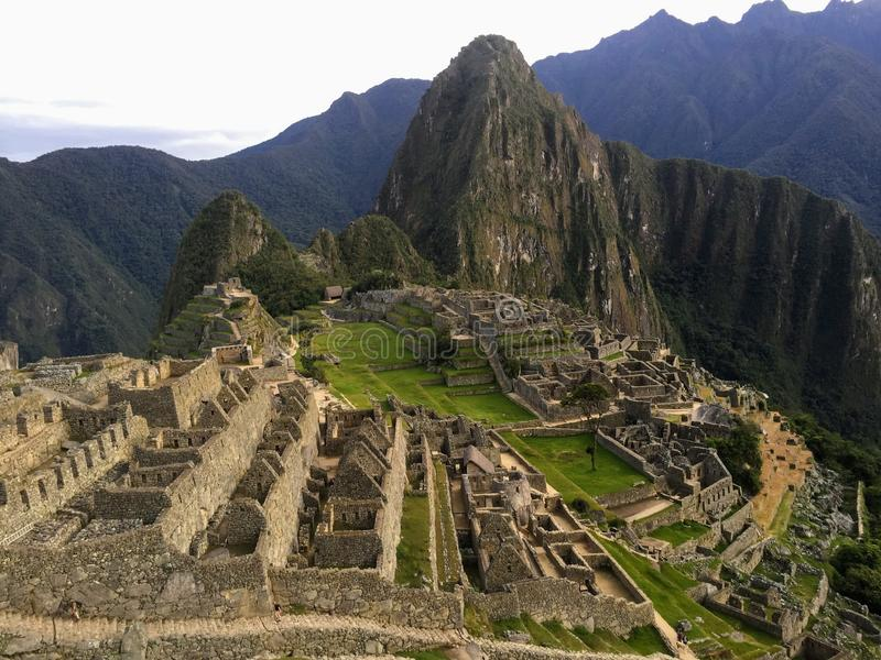 An early morning photo of Machu Picchu with no people on the site, on a beautiful day in May. Huayna Picchu is in the backgroun stock image