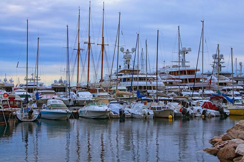 Early morning in port of Monaco. Rows of luxury yachts and different boats moored at the pier. Landscape view of port in Monaco royalty free stock image