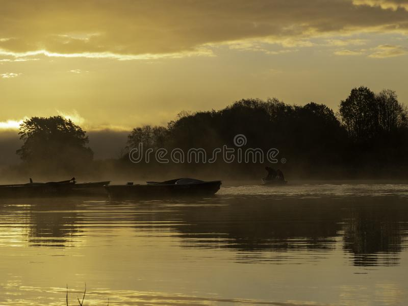Early morning on the river with boats. Charming sunrise stock photos