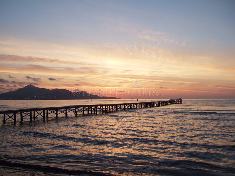Early morning sky. Just before sun rise with jetty in foreground royalty free stock photos
