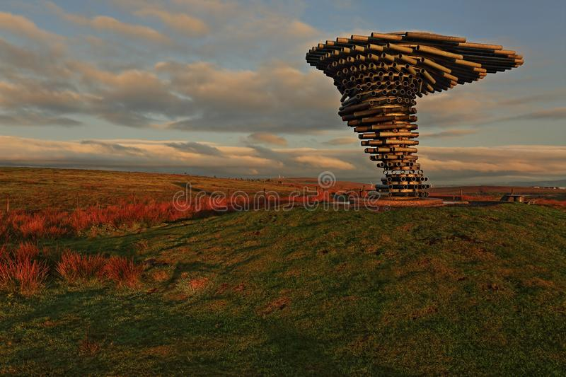 Singing Ringing Tree, Crown Point, Burnley. The early morning sun casts a warm glow on the Singing Ringing Tree panopticon that can be found at the top of Crown royalty free stock images