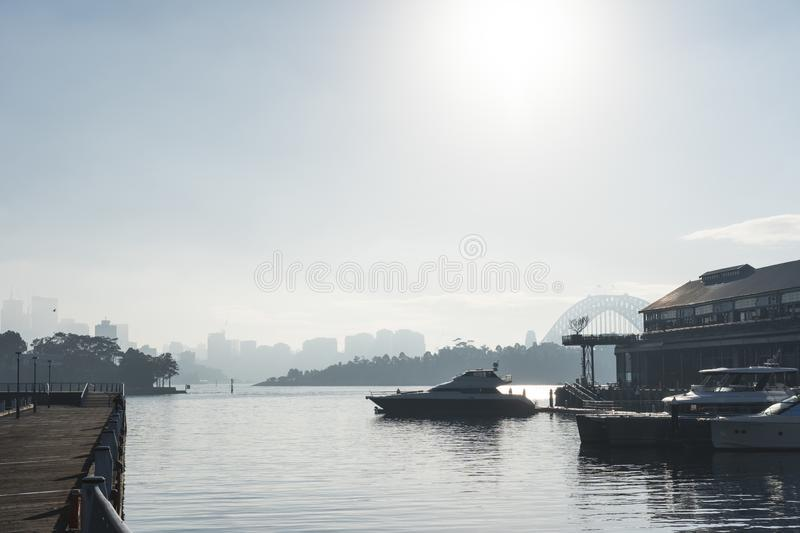 Early morning sun haze over the water at Pirrama Park/Jones Bay Wharf, Sydney NSW. June 2019. Taken from the boardwalk section of Pirrama Park. Portrait royalty free stock photos