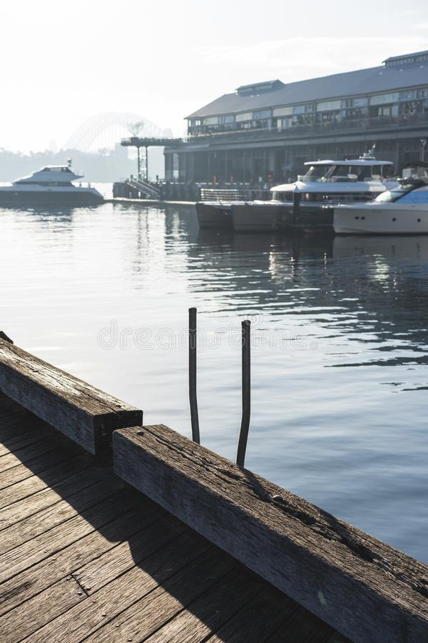 Early morning sun haze over the water at Pirrama Park/Jones Bay Wharf, Sydney NSW. June 2019. Taken from the boardwalk section of Pirrama Park. Portrait royalty free stock photography