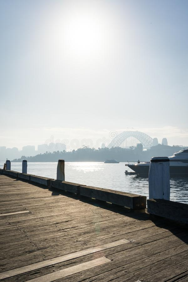Early morning sun haze over the water at Pirrama Park/Jones Bay Wharf, Sydney NSW. June 2019. Taken from the boardwalk section of Pirrama Park. Portrait stock images