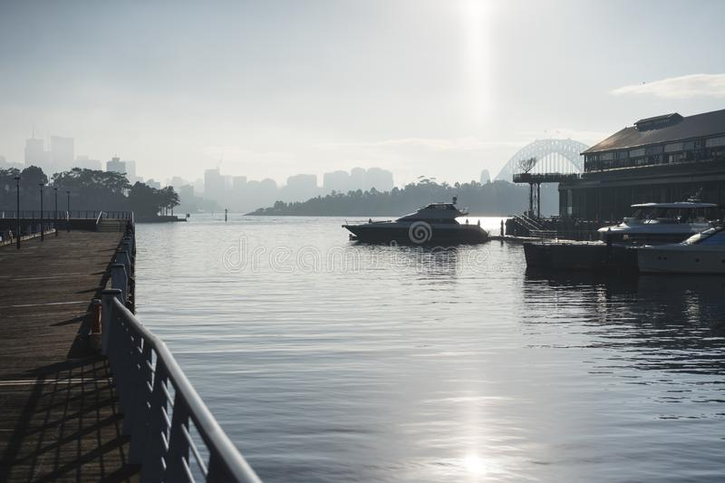 Early morning sun haze over the water at Pirrama Park/Jones Bay Wharf, Sydney NSW. June 2019. Taken from the boardwalk section of Pirrama Park. Portrait royalty free stock images