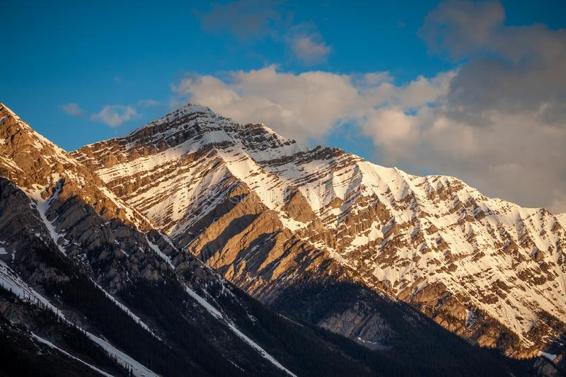 The early morning sun lighting up a mountain in Kananaskis Country, Alberta stock photos