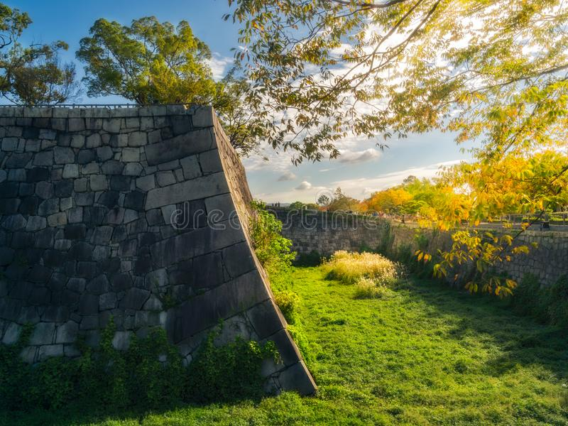 Early morning sun at the moat and fortifications of Osaka Castle in Japan stock image