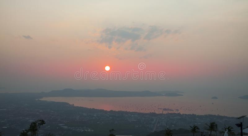 Early morning. Sun rises above island. Sunrise over the lagoon with many boats. royalty free stock images
