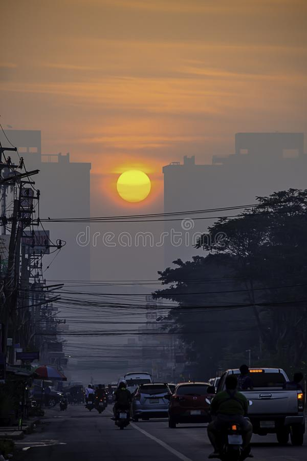 The early morning sunlight shining on buildings and the cars on the road at Bangyai City of Nonthaburi in Thailand. January 14, royalty free stock images
