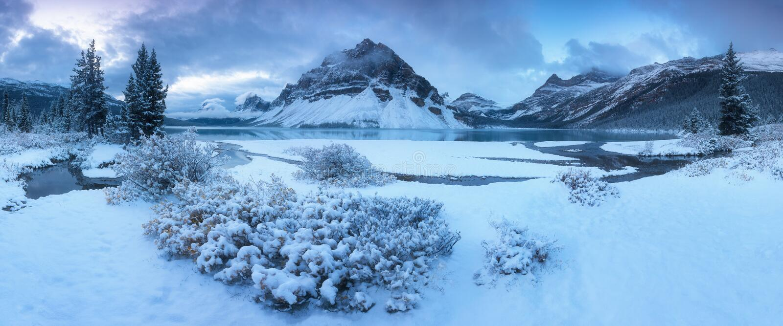 Early morning sunrise at the Bow lake and Crowfoot mountain. Bow Lake is a small lake in western Alberta, Canada. royalty free stock photos