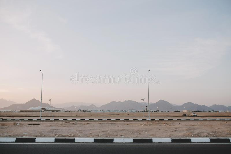 Early morning sunrise, landscape with mountains on road of tropical counrty. Blue sky, summer, nature, travelling far royalty free stock photo