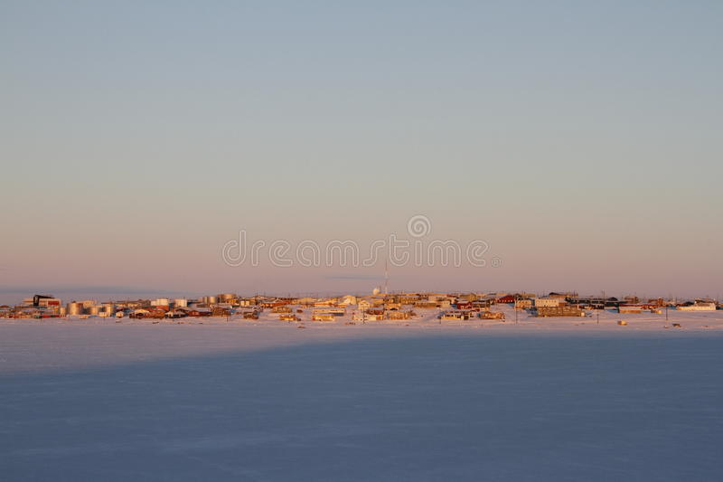 Early morning winter sunrise over Cambridge Bay, Nunavut. Early morning sunrise over Cambridge Bay, Nunavut in winter stock photo