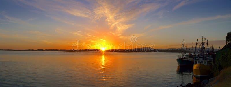 Early morning - sunrise over fishing harbor stock photos