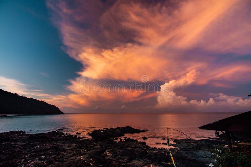 Early morning , sunrise over sea. Pink magic sunset on the island of Lanta,. Thailand. Rocky coast, dark key royalty free stock images