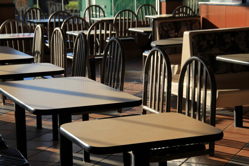 Early morning sunshine on tables and booths of restaurant. Not yet open for business royalty free stock photography