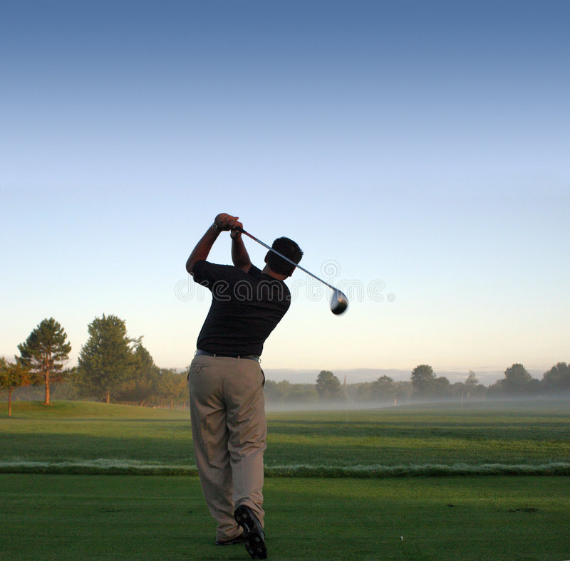 Early morning tee off. royalty free stock photo