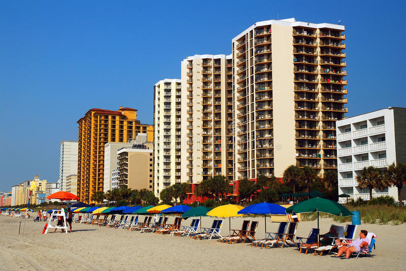 Early Morning, before theh Crowds, on Myrtle Beach. Beach Chairs and Umbrellas await the summer crowd stock photography