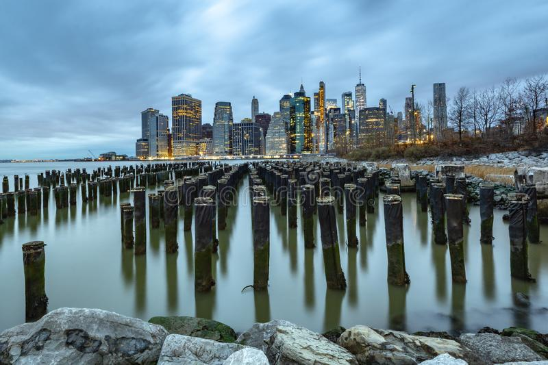 Early morning view of Lower Manhattan. Long exposure shot of New York City. Shot from Brooklyn Bridge Park with the East River in the foreground stock images