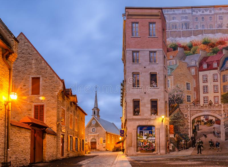 Place Royale in Old Quebec city, Canada. Early Morning View of Notre-Dame-des-Victoires Church and murals of Quebec city in Place Royale of Old Quebec city stock image
