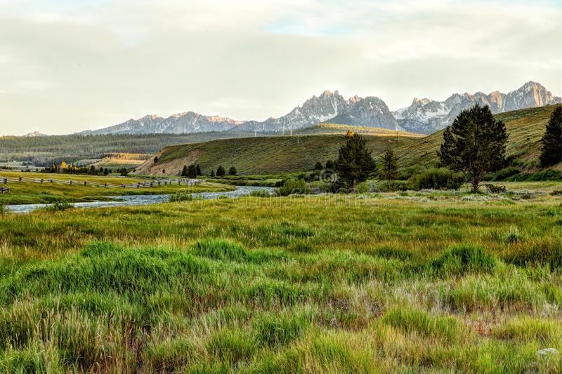 A distant view of the Sawtooth Mountains in central Idaho. An early morning view of the Sawtooth Mountains in Idaho, looking over the Salmon River royalty free stock photography