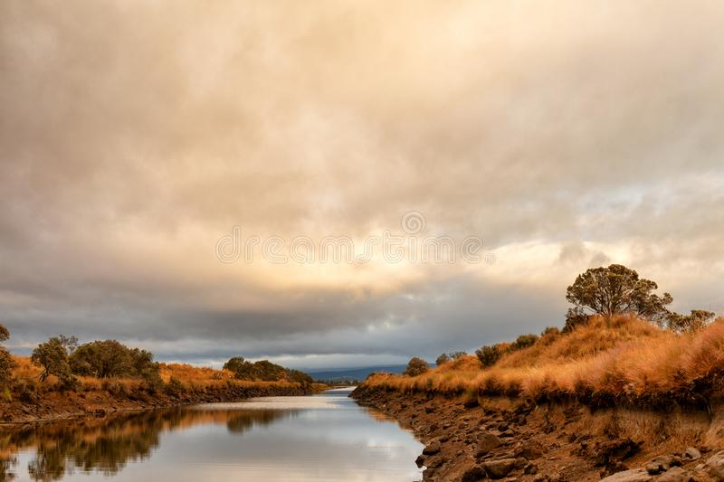 Early morning view of waterway. With sunrise clouds reflecting in the water royalty free stock photos