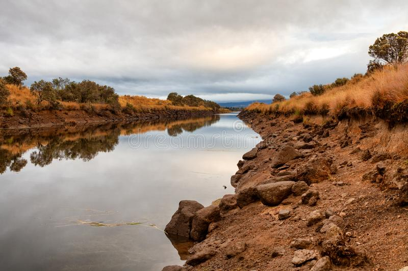 Early morning view of waterway. With sunrise clouds reflecting in the water stock photos