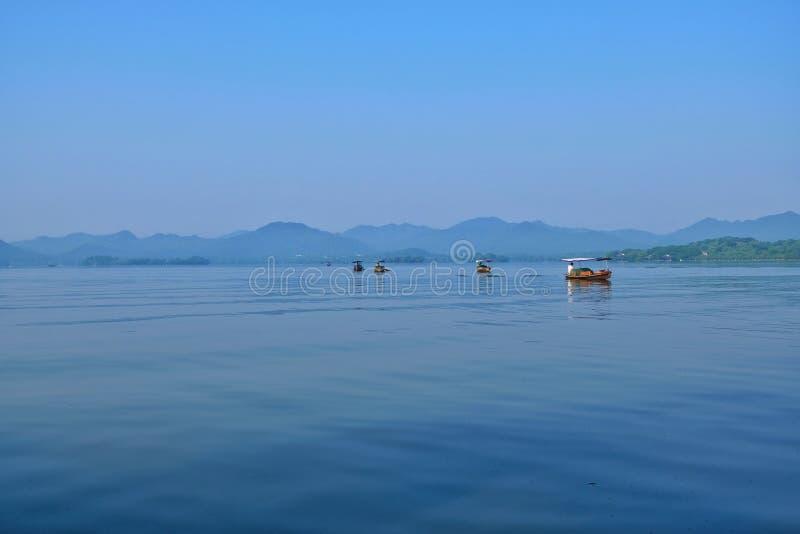 Hangzhou West Lake, Zhejiang, China 杭州. Early morning walk along the touristy Hangzhou West Lake stock photo