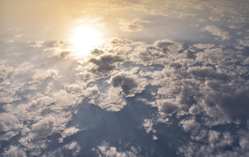Early morning Warm clouds with sunlight. A photograph of early morning warm clouds with sunlight with a different perspective of the sun royalty free stock photography