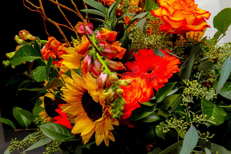 Bride`s Autumn Bouquet. Early November wedding and the bride chose harvest colors for her bouquet royalty free stock image