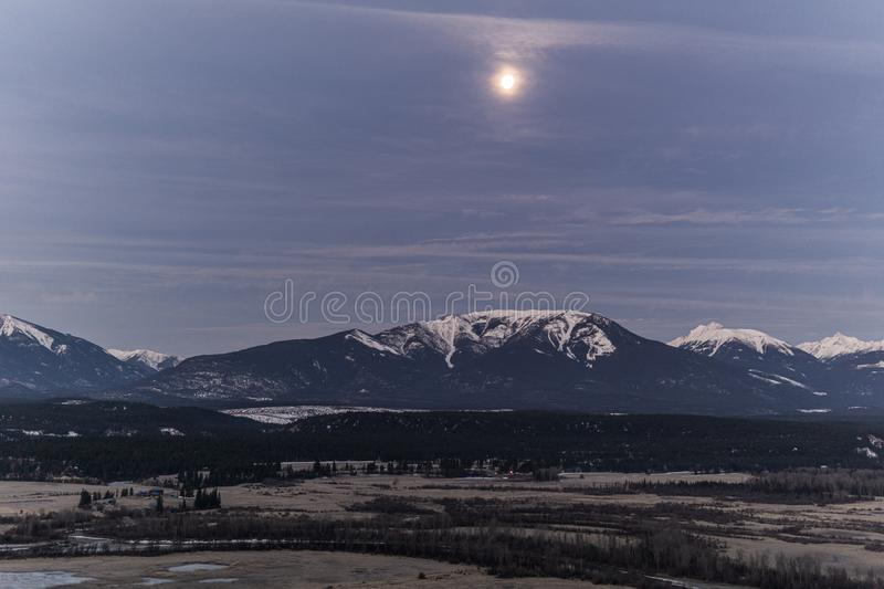 early spring morning at columbia river valleynear Radium Hot Springs with rocky mountains on the background royalty free stock photos