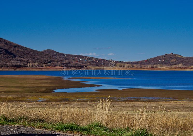 Late Afternoon at the Lake. Early spring at Vega State Park in Western Colorado. Blue skies in late afternoon stock photos