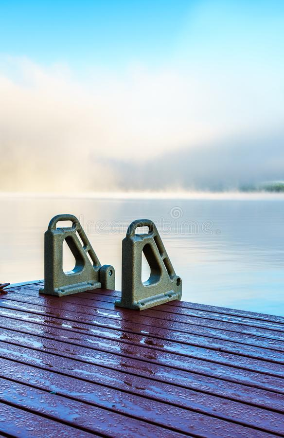 Dock in the early morning mist stock image