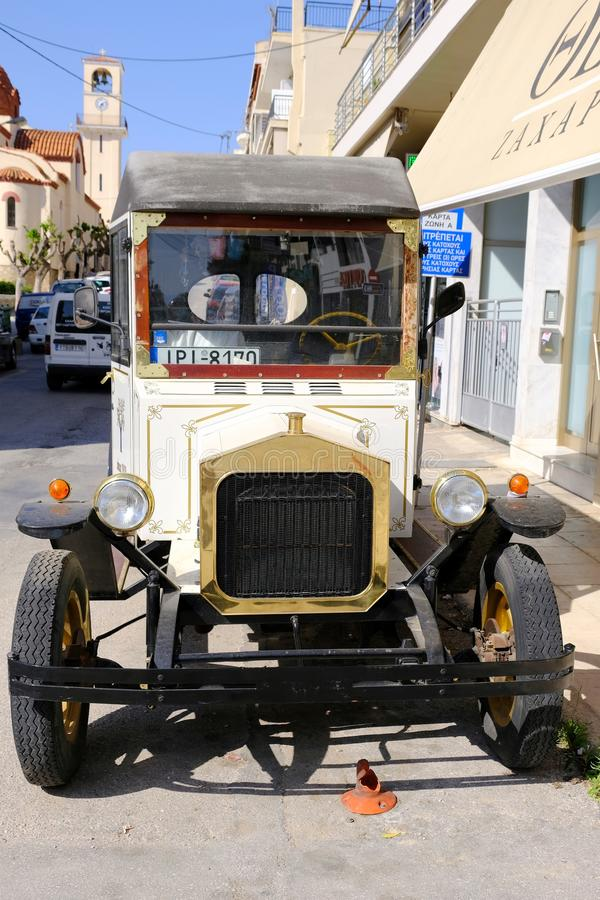 Antique Delivery Van at a Greek cake Shop, Greece. An early 20th century antique delivery van belonging to a traditional cake and cookie shop in Rafina, near stock image